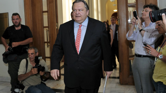 Pasok party leader Evangelos Venizelos arrives for a meeting with New Democracy leader, Antonis Samaras at the Greek Parliament in Athens on June 20, 2012. Greece