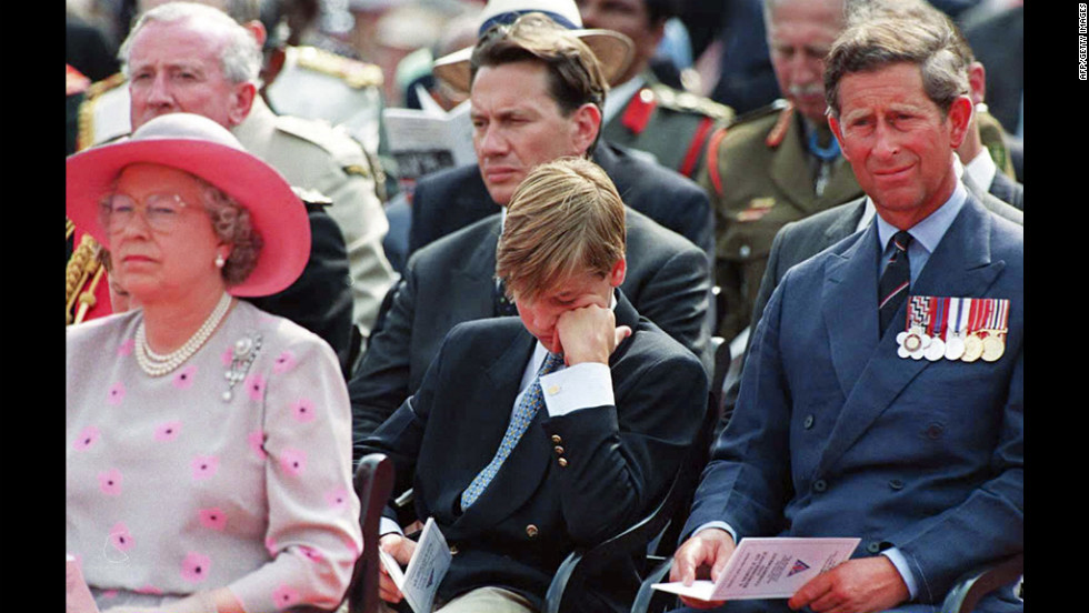 Queen Elizabeth II, Prince William and Prince Charles attend a service commemorating VJ Day outside Buckingham Palace in August 1995. The event was in honor of the day Japan surrendered to Allied forces, effectively ending World War II.