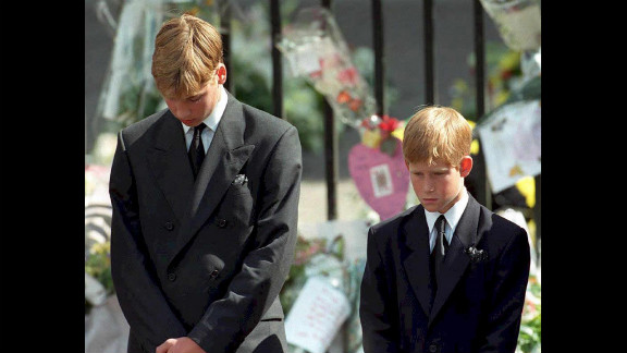 At age 15, Prince William and his brother Harry, 12, bow their heads after their mother