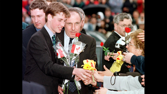 Prince William receives flowers from an adoring crowd in Vancouver on March 24, 1998. He was on a weeklong vacation with his father and brother, though they also made time for official engagements.