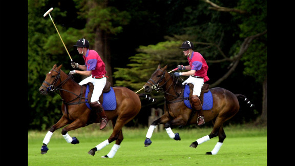 In 2001, Prince William, left, and Prince Harry take part in an exhibition polo match in Gloucestershire, England.