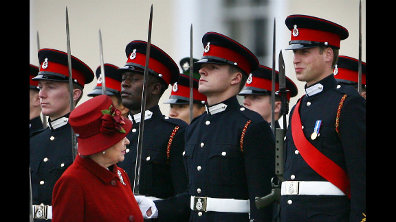 Queen Elizabeth glances up at her grandson, right, as she inspects the parade at the Royal Military Academy in 2006. Prince William graduated as an Army officer and later went on to receive his Royal Air Force pilot