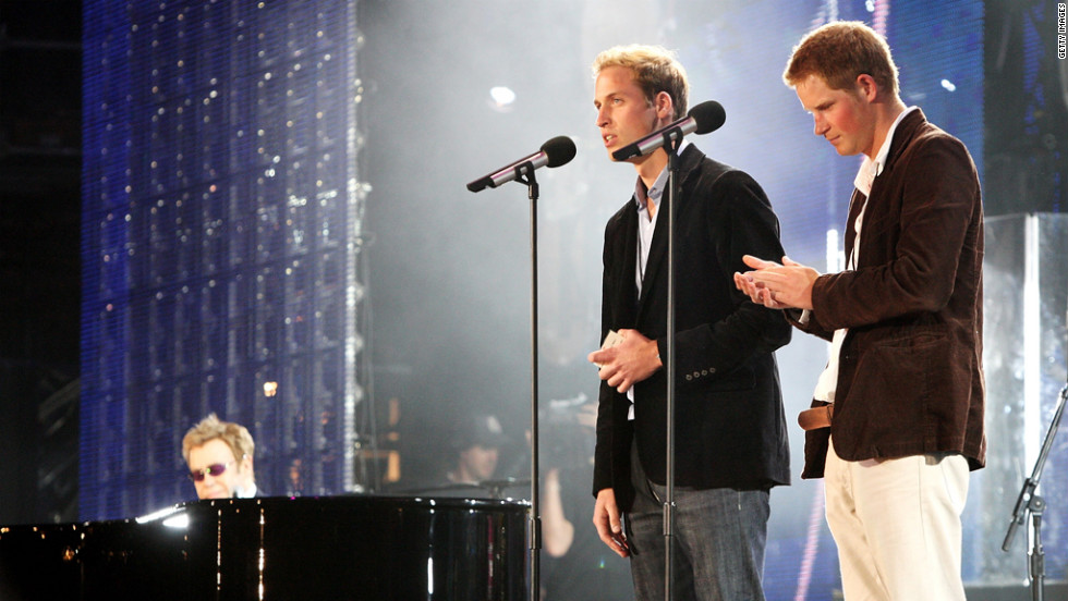 Prince William and Prince Harry speak on stage with Sir Elton John, far left, during a concert they put on to celebrate Princess Diana on July 1, 2007. The event fell on what would have been their mother's 46th birthday and marked 10 years since her death.