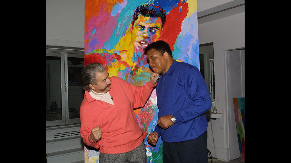 Muhammad Ali and  Neiman clown around during Ali