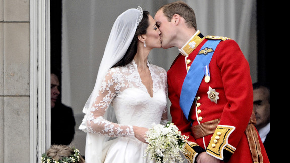 After their wedding service, Prince William kisses his wife, Kate Middleton, on the balcony of Buckingham Palace on April 29, 2011.