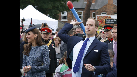 Prince William throws a foam javelin as his wife, now the Duchess of Cambridge, stands at his side during a visit to Nottingham, England, on June 13, 2012. The couple were in the city as part of Queen Elizabeth II