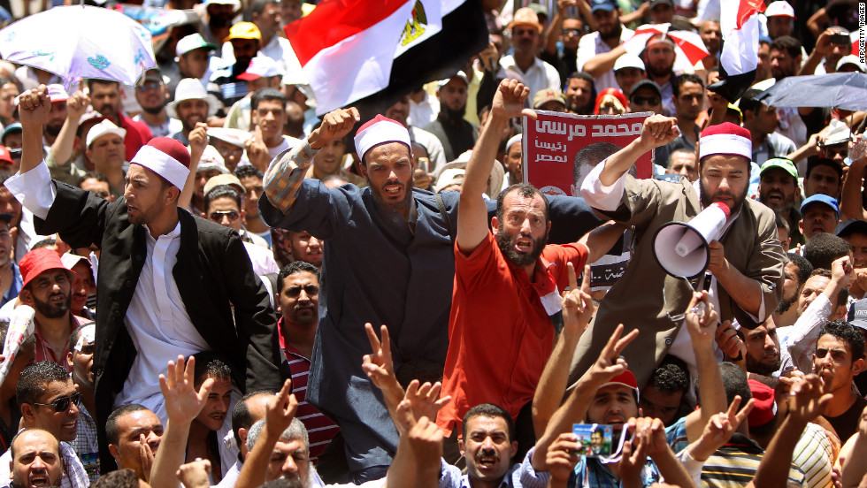 Muslim clerics join demonstrators in Cairo's Tahrir Square on Thursday to protest the delay of the presidential election results. The Presidential Election Commission postponed the release of the presidential election results, and both candidates have declared themselves winners.