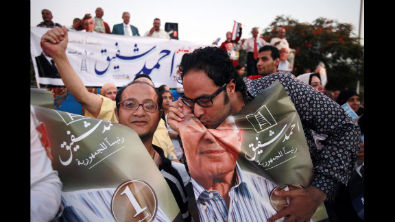 A supporter of Egyptian presidential candidate Ahmed Shafik kisses a portrait of him during a Cairo rally Wednesday, June 20. Shafik was the last prime minister to serve under Hosni Mubarak