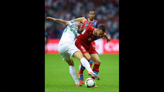 Helder Postiga of Portugal tackles Tomas Sivok of Czech Republic during the quarter-final match.
