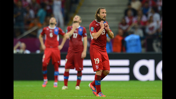 Petr Jiracek of the Czech Republic and teammates look dejected after conceding the opening goal to Portugal.