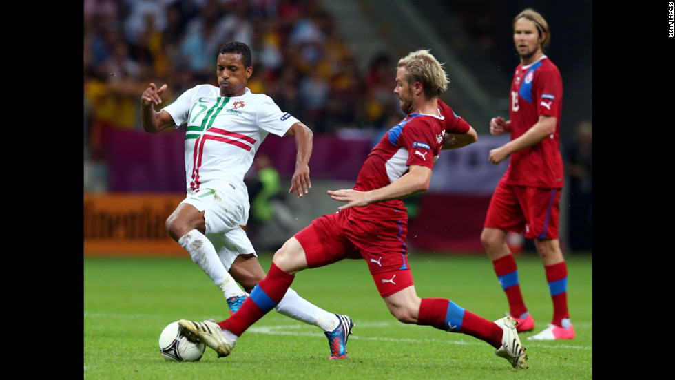 Tom Hubschman of Czech Republic defends against Portugal's Nani during the quarter final between Czech Republic and Portugal at The National Stadium on June 21, 2012 in Warsaw.