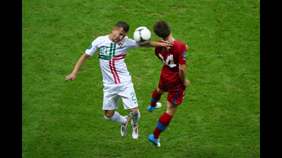 Joao Pereira of Portugal and Vaclav Pilar of Czech Republic jump for the ball.