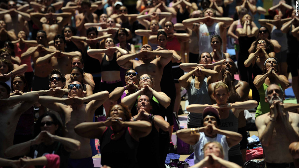 Thousands participate in a yoga session Wednesday in New York's Times Square to commemorate summer solstice.