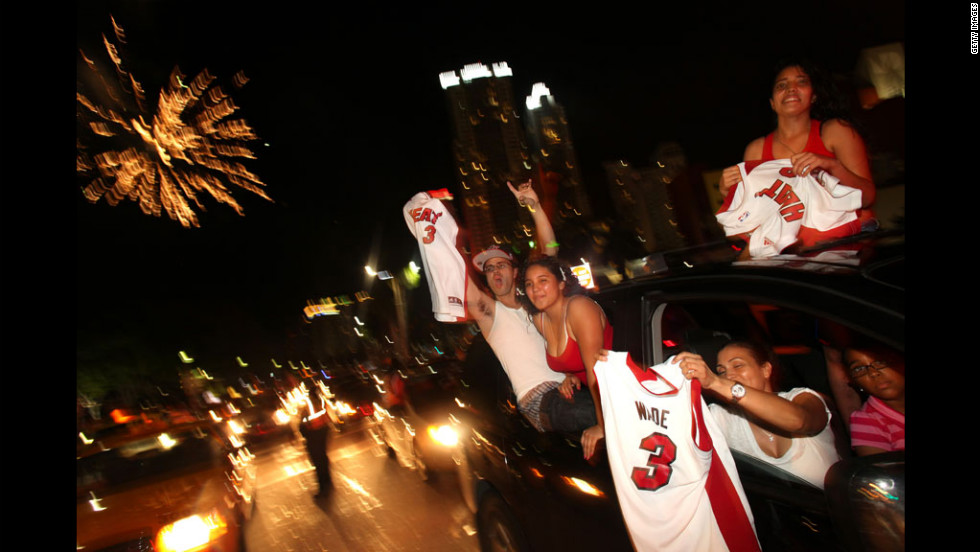 Fans celebrate the Miami Heat's victory over the Oklahoma City Thunder in the 2012 NBA Finals.