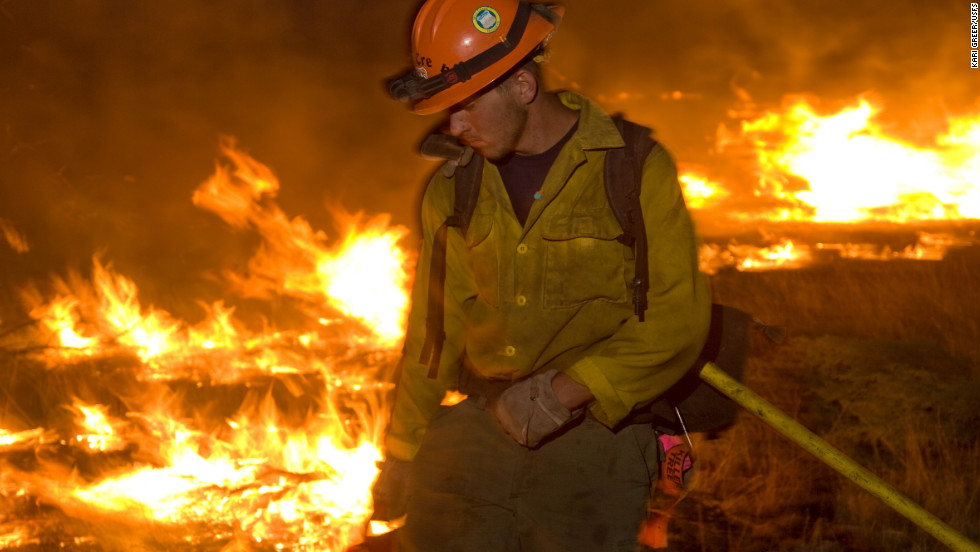 "<a href=""http://www.kariphotos.com/"" target=""_blank"">Photographer Kari Greer </a>has spent years documenting wildfires and firefighters in much of the United States. In this photo, a firefighter works a low-intensity burn operation June 14 at Lincoln National Forest in New Mexico."