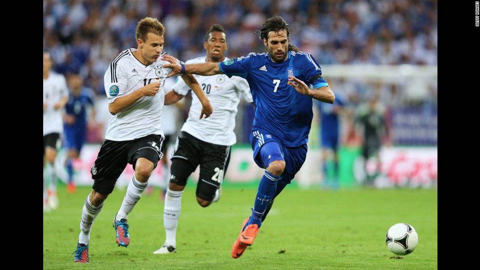 Germany's Holger Badstuber chases down Greece's Georgios Samaras during the Euro 2012 quarterfinal match at the Municipal Stadium in Gdansk, Poland.