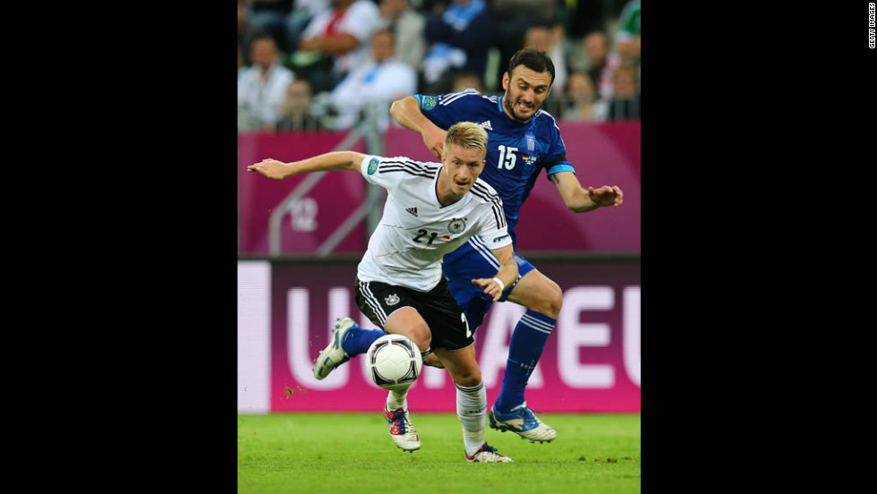 Vasilis Torosidis of Greece shadows Marco Reus of Germany during their Euro 2012 quarterfinal match in Gdansk, Poland.