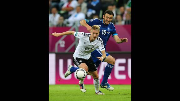 Vasilis Torosidis of Greece shadows Marco Reus of Germany during their Euro 2012 quarterfinal match in Gdansk, Poland.