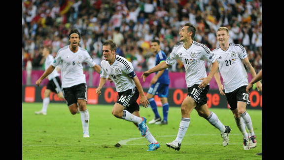 Philipp Lahm, Marco Reus and Miroslav Klose celebrate a goal that put Germany ahead of Greece 1-0 in Friday