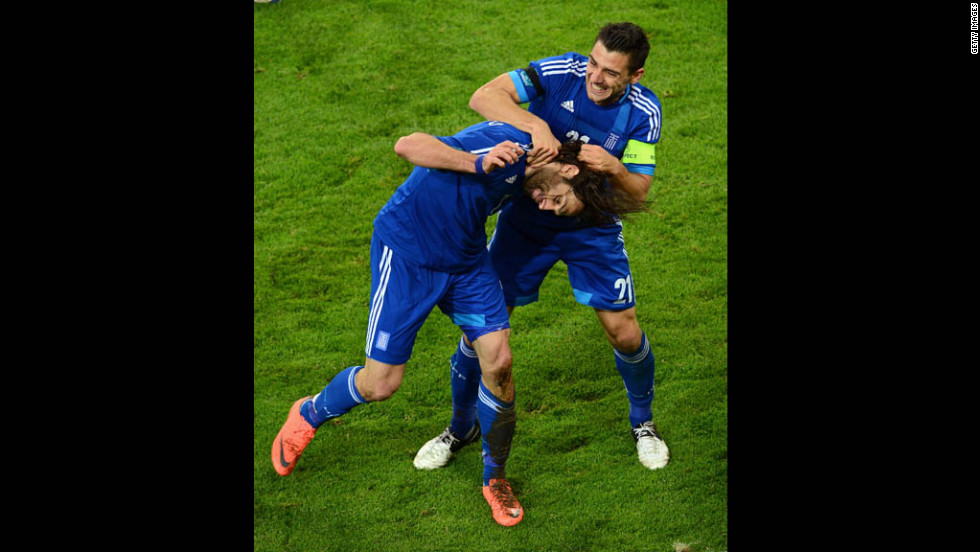Georgios Samaras and Kostas Katsouranis celebrate scoring a goal that tied their game against Germany, 1-1, during a quarterfinal match at Euro 2012 in Gdansk, Poland.