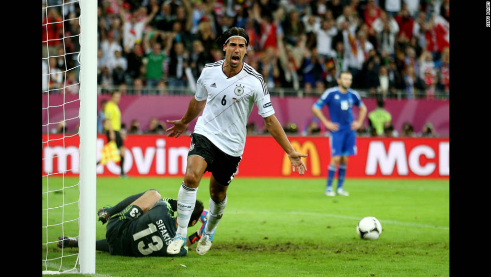 Sami Khedira celebrates scoring a goal that put Germany ahead 2-1 against Greece on Friday, June 22, during a quarterfinal match in Gdansk, Poland.