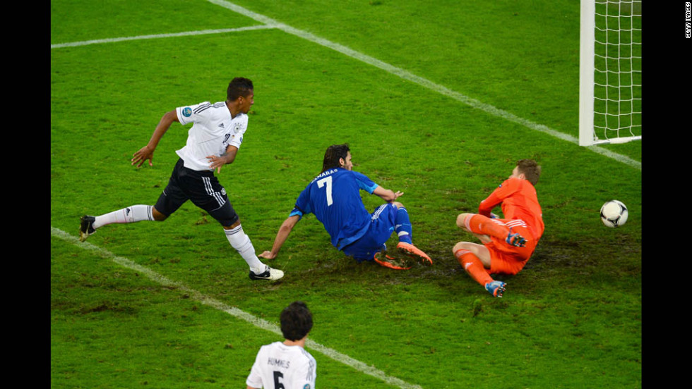 Georgios Samaras scores Greece's first goal past German goalkeeper Manuel Neuer.