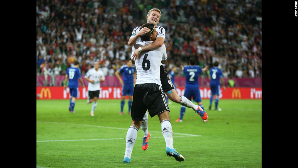 Sami Khedira of Germany celebrates scoring the team's second goal with Bastian Schweinsteiger of Germany against Greece.