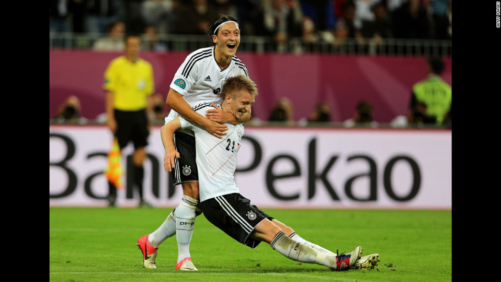 Marco Reus of Germany celebrates scoring the team's fourth goal with Mesut Ozil.
