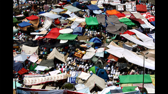 Protesters perform Friday noon prayer under tents erected in Cairo
