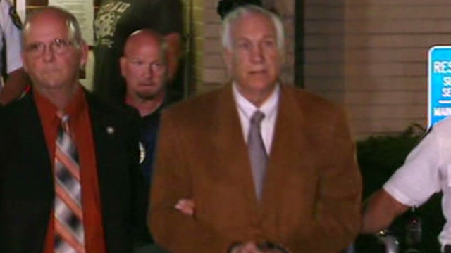 Watch Sandusky be led out of court