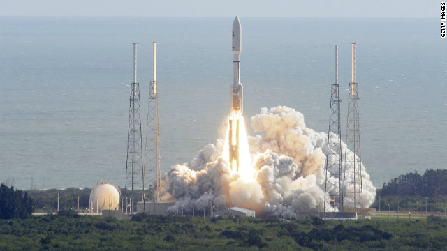 NASA's Curiosity rover, formally known as the Mars Science Laboratory, heads for space on November 26, 2011 atop an Atlas 5 rocket at Cape Canaveral, Florida.