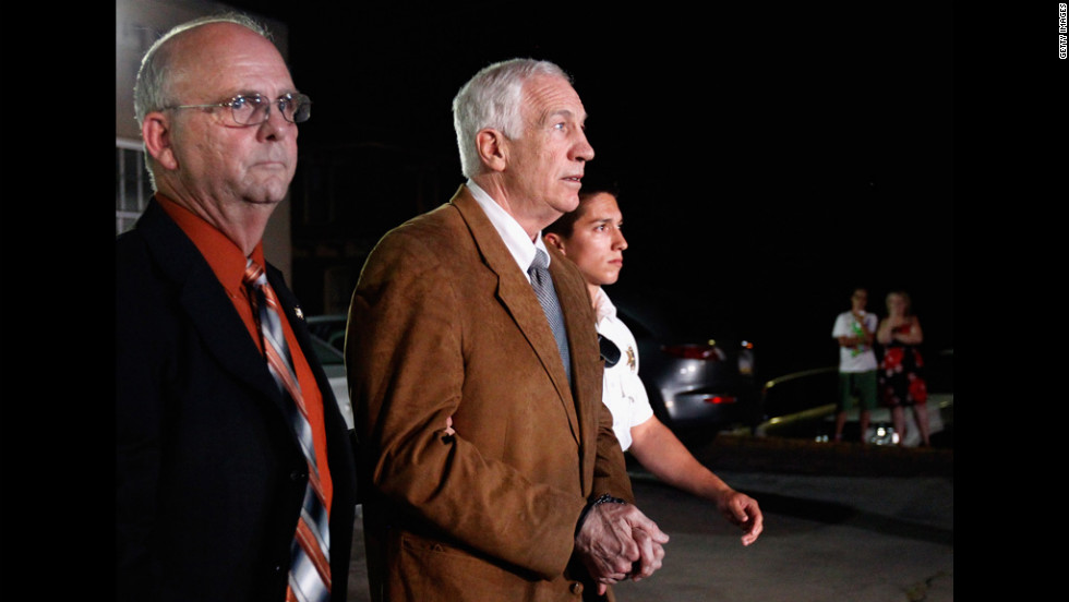 Former Penn State assistant football coach Jerry Sandusky leaves the Centre County Courthouse in handcuffs after a jury found him guilty in his sex abuse trial on Friday, June 22.