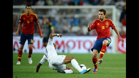 Jordi Alba of Spain challenges Yann M