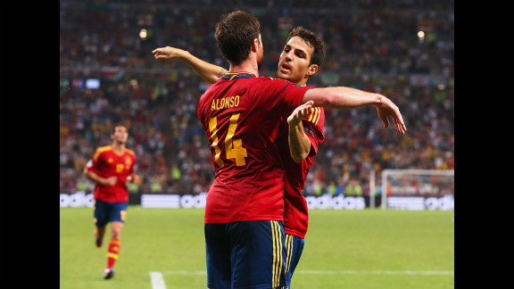 Xabi Alonso of Spain celebrates after scoring the first goal with Cesc Fabregas during Spain