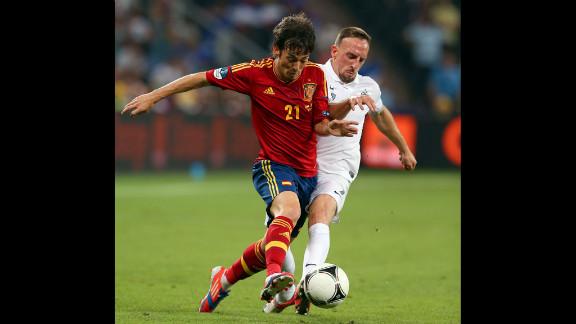 Franck Ribery of France challenges David Silva of Spain.