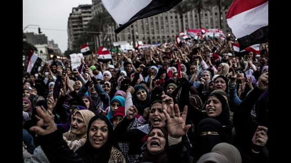Female supporters of Mohamed Morsi, the Muslim Brotherhood's candidate, protest against Egypt's military rulers in Tahrir Square in Cairo on Saturday, June 23. Egyptian election officials had postponed the announcement of a winner in last weekend's presidential runoff, stating they needed more time to evaluate charges of electoral abuse that could affect who becomes the country's next president.