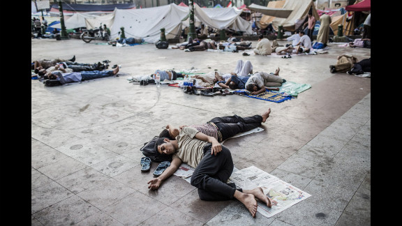 Protesters sleep as they camp overnight in Tahrir Square.