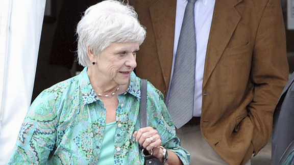 Dottie Sandusky, who has been married to Sandusky for 46 years, walks with her husband while jurors deliberate. She testified that she did not witness any sexual abuse.