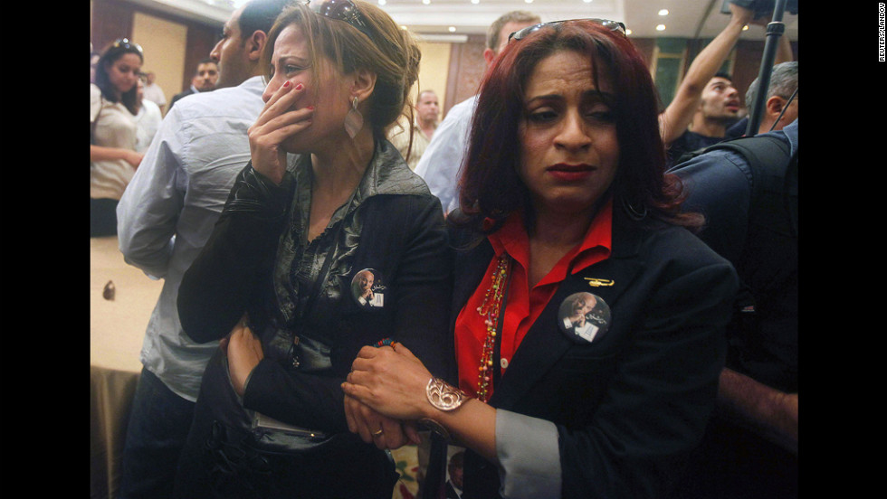 Supporters of presidential candidate Ahmed Shafik react after hearing the results of the presidential elections in Cairo on June 24.