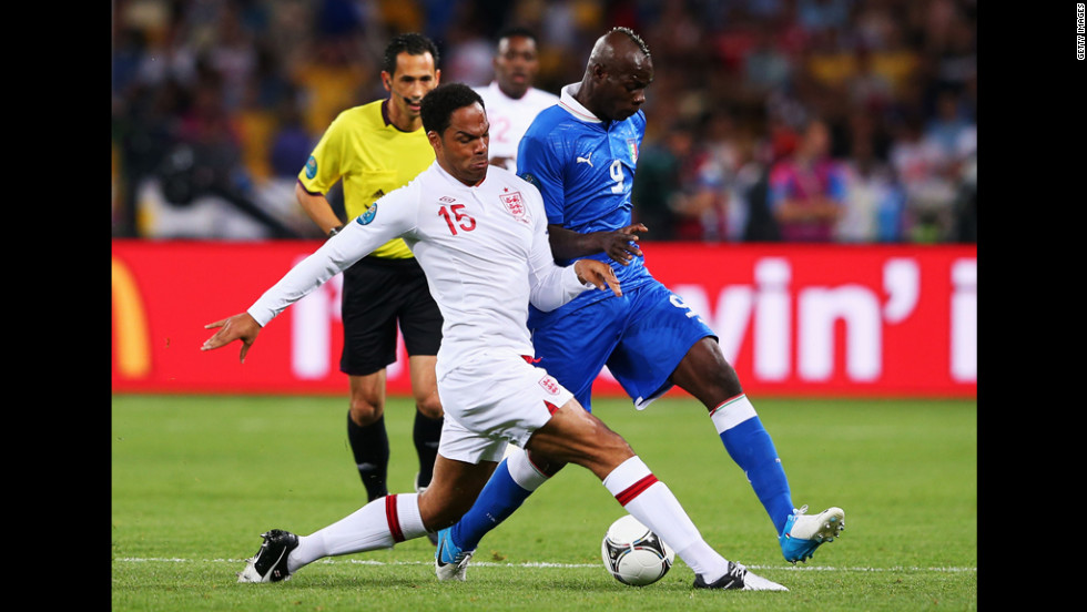 Joleon Lescott of England challenges Mario Balotelli of Italy.