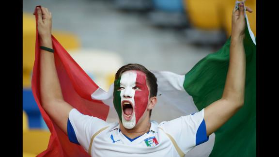 An Italy fan enjoys the atmosphere ahead of Sunday