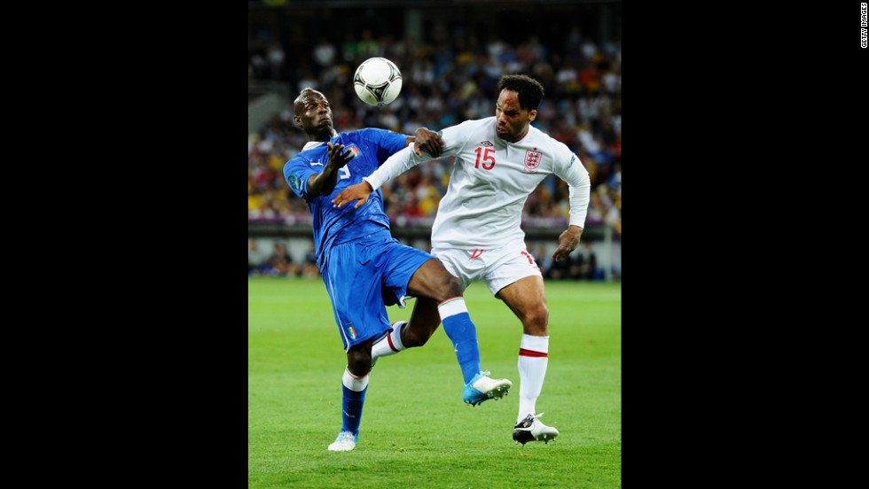 Mario Balotelli of Italy challenges Joleon Lescott of England.