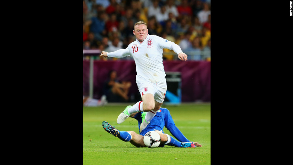 Wayne Rooney of England goes after the ball during the match against Italy.