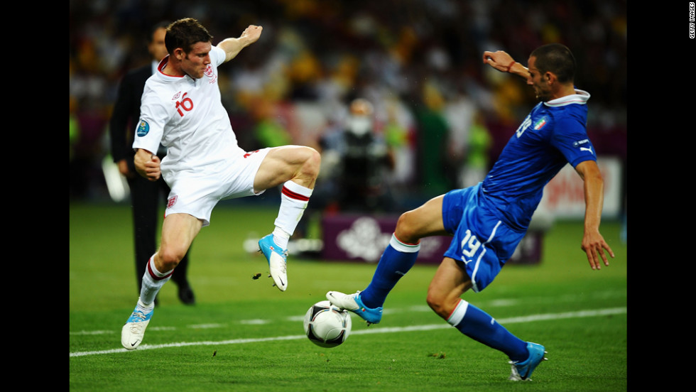 James Milner of England competes with Italy's Leonardo Bonucci.