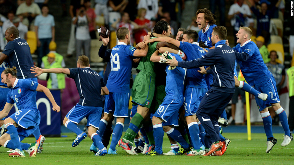 Italy's national team celebrates after winning the penalty shootout in the quarterfinal match against England on Sunday, June 24, in Kiev, Ukraine.