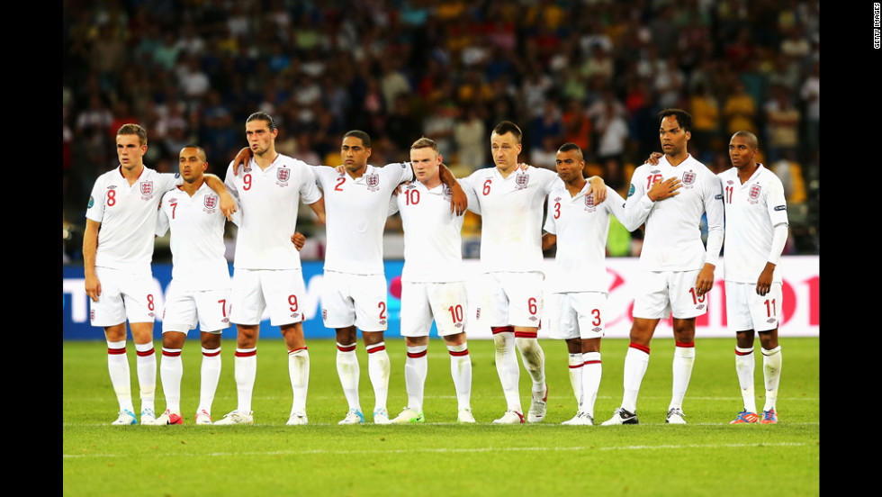 The English players line up during the penalty shootout against Italy.