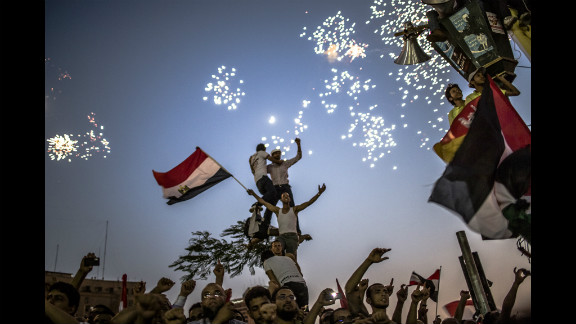 As fireworks burst overhead, Egyptians in Tahrir Square celebrate Mohamed Morsi