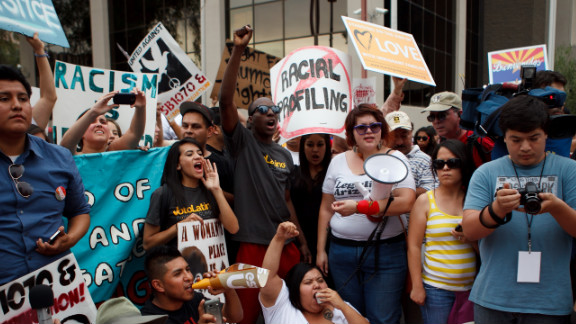 People opposed to Arizona's SB 1070 rally for immigrant rights in April in Phoenix.