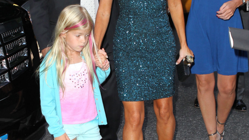 Denise Richards leaves her hotel with her daughter and Charlie Sheen in New York City.