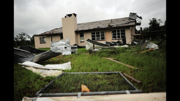 A house in Lecanto, Florida, is damaged after a tornado associated with Tropical Storm Debby passed through over the weekend. The slow mover has buffeted parts of Florida with driving rains and high winds as it hovered off the Gulf of Mexico.